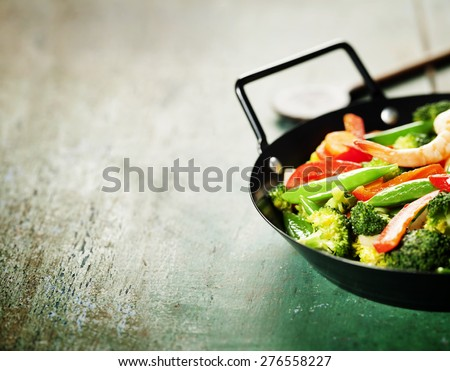 Fresh vegetables and shrimps on pan. Food background - stock photo