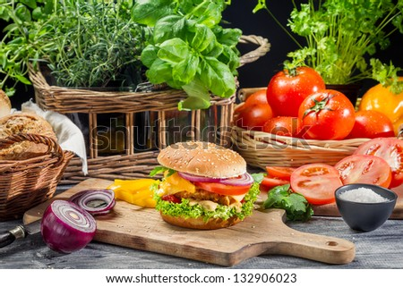 Fresh vegetables as ingredients for homemade hamburger - stock photo