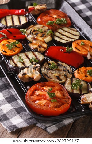 Fresh vegetables cooked on the grill pan closeup. vertical  - stock photo