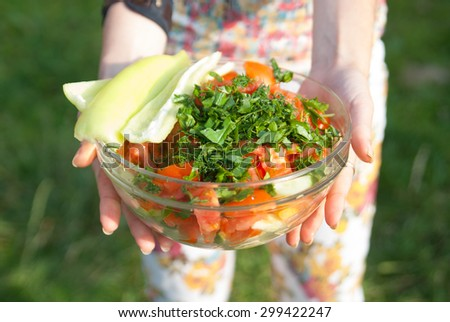 fresh vegetables in a glass bowl. salad of tomatoes, bell pepper, cucumber and greens. - stock photo