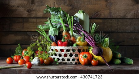 Fresh vegetables in basket on the table: tomato, pepper, beet, cucumber, zucchini, eggplant and others. Still life in rustic style. Food. - stock photo