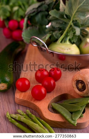 Fresh Vegetables in metal bowl on a wooden board - stock photo