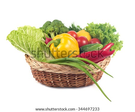 fresh  vegetables in the basket isolated on white background - stock photo