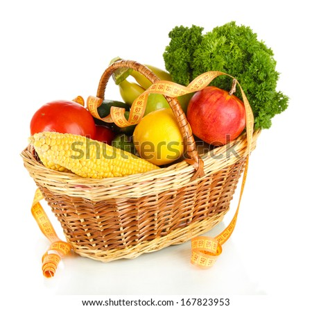 Fresh vegetables in wicker basket isolated on white - stock photo