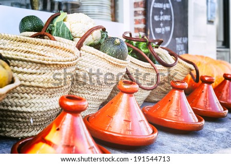 Fresh vegetables in wicker baskets with traditional tagines - stock photo