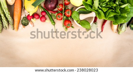 Fresh vegetables on a brown background - stock photo