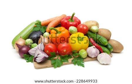 fresh vegetables on a cutting board isolated on white background. horizontal photo. - stock photo