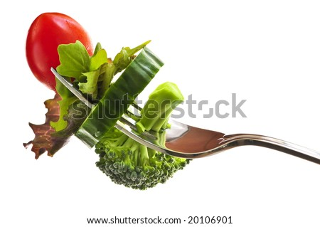 Fresh vegetables on a fork isolated on white background - stock photo