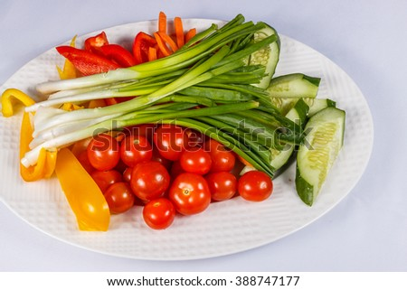 Fresh vegetables on a plate. Health food, organic vegetables - stock photo