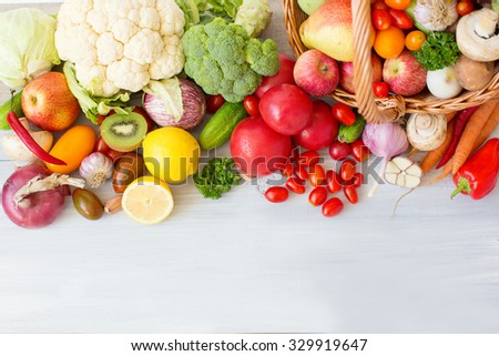 Fresh vegetables on a wooden background. Top view. - stock photo