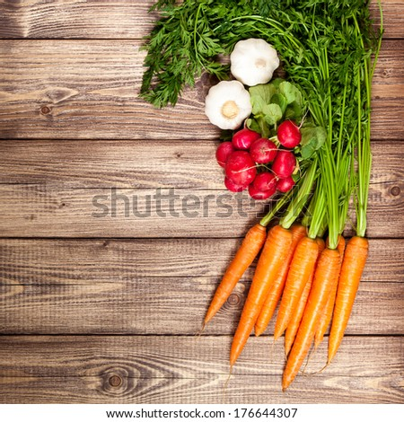 Fresh vegetables on a wooden table - stock photo
