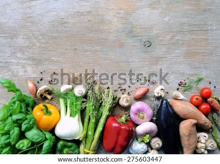 Fresh vegetables on a wooden table. Background. Healthy lifestyle - stock photo