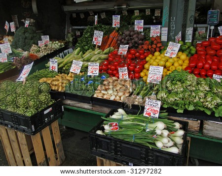 Fresh vegetables on display at farmer's market,  Pike Place Market,   Seattle, Pacific Northwest - stock photo