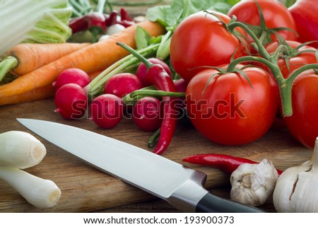 Fresh vegetables on kitchen board - stock photo