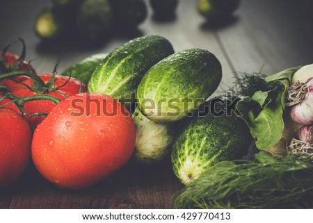 fresh vegetables on the brown wooden table - stock photo
