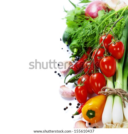 fresh vegetables on the white background - healthy or vegetarian eating concept - stock photo