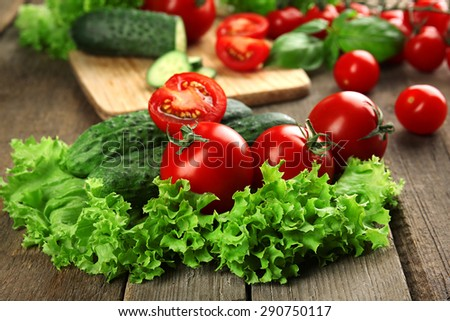 Fresh vegetables on wooden table, closeup - stock photo