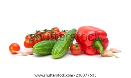 fresh vegetables - red peppers, garlic, cherry tomatoes and cucumbers on a white background. horizontal photo. - stock photo