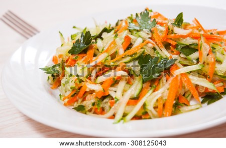 fresh vegetables salad with cucumber and carrot - stock photo