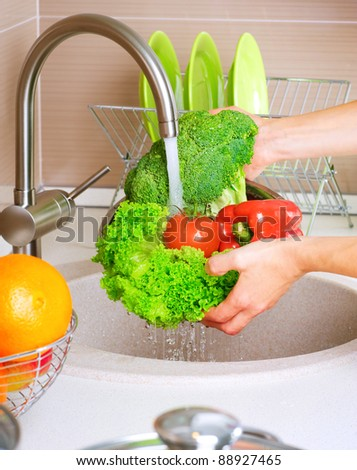 Fresh Vegetables Washing.Healthy Food.Kitchen - stock photo