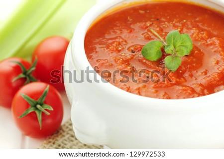 Fresh vegetarian homemade pureed tomato and celery soup - stock photo
