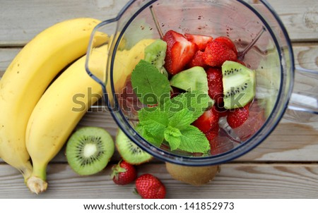 Fresh vivid smoothie ingredients and blender - stock photo