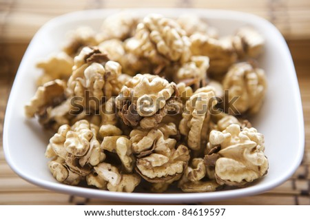 fresh walnuts on the white plate - stock photo