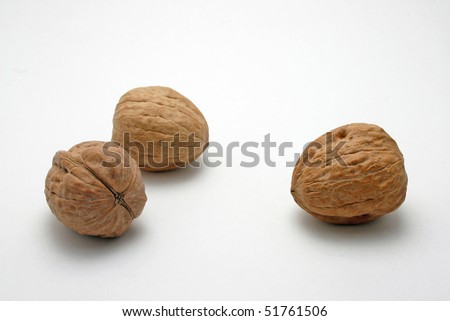 Fresh walnuts on white background. - stock photo