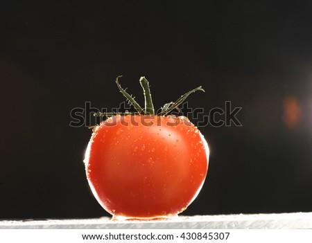 FRESH, WASHED CHERRY TOMATO , ON BLACK BACKGROUND - stock photo