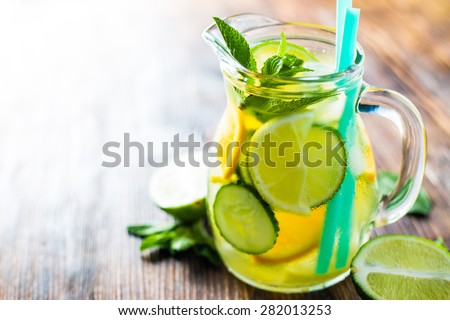 Fresh water with fruit - stock photo