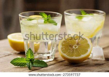 Fresh water with lemon, mint and cucumber, selective focus - stock photo