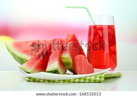 Fresh watermelon and glass of watermelon juice - stock photo