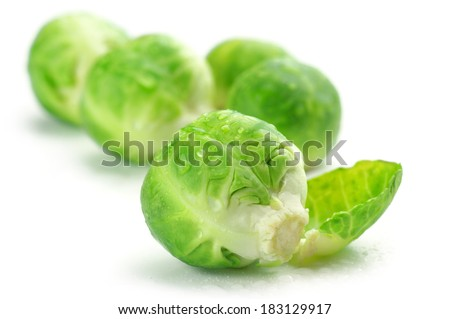 Fresh wet brussel sprouts isolated on white background. - stock photo