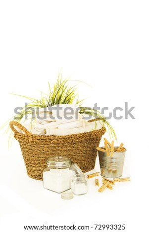Fresh white towels with powder soap, and clothespins for the laundry day - stock photo