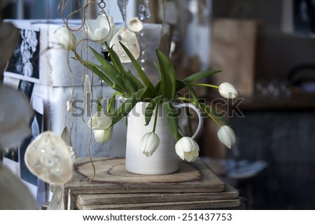 fresh white tulips on kitchen background - stock photo