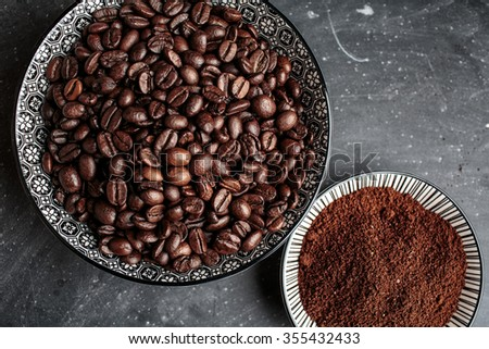 Fresh whole Coffee Beans and Ground Coffee on plate - stock photo