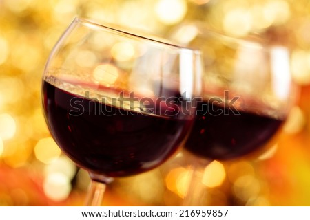 Fresh wine against autumnal lights background. - stock photo