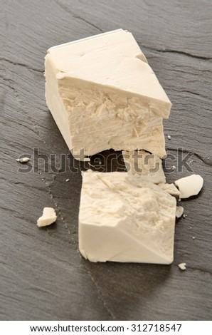 fresh yeast on a grey slate - stock photo