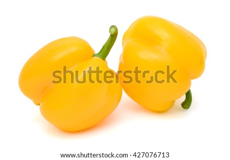 Fresh yellow bell peppers isolated on white background - stock photo