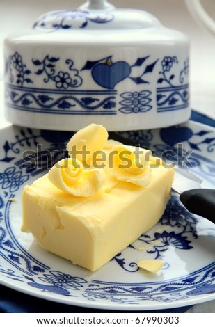 fresh yellow butter on a special plate - stock photo
