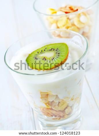 fresh yogurt and muesli in a glass - stock photo