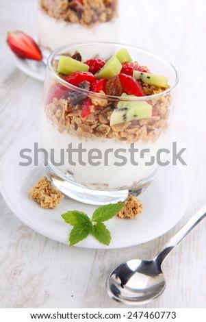 fresh yogurt with fruits and granola  - stock photo