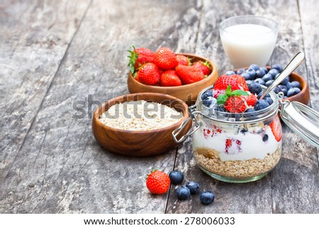 fresh yogurt with oat flakes and berries - stock photo