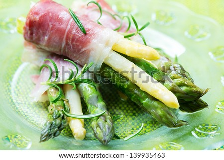 Fresh Young Asparagus wrapped in Prosciutto ham - stock photo