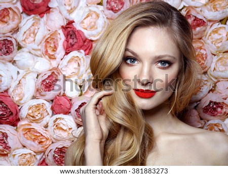 Fresh young fashion model with red lips. Wedding make up. Roses. Flowers background. Spring. - stock photo