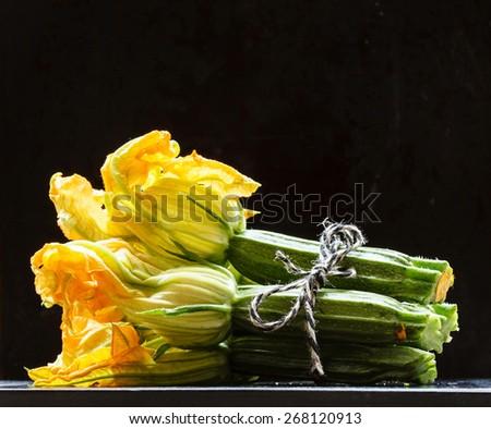 fresh zucchini flowers - stock photo