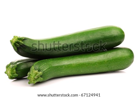 fresh zucchini's on a white background - stock photo