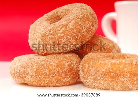 Freshly baked apple cinnamon doughnuts with coffee - stock photo