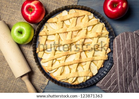 Freshly baked apple pie with fruits - stock photo