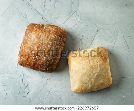 freshly baked bread buns, top view - stock photo